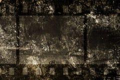 在grunge背景的Cinefilm 免版税库存图片