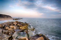 在Hengistbury顶头海滩的日落 库存图片