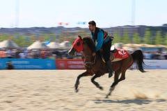 在Jereed比赛的行动-土耳其语Cirit Sporu 库存照片