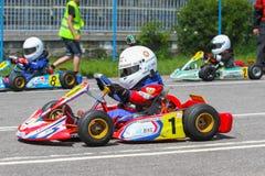 在karting的赛车手 图库摄影