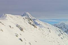 在Kasprowy Wierch上的云彩在扎科帕内在Tatra在wint登上 免版税库存图片