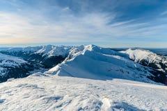 在Kasprowy Wierch早晨foto附近的积雪覆盖的高Tatras 免版税图库摄影