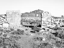 在kleovoulos小山的古老风车在Lindos 库存照片