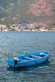 在Kotor海湾的一条小船 免版税图库摄影