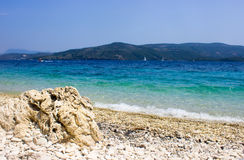 在Lakka海滩的石头 免版税库存照片