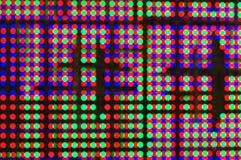 在LED屏幕上的五颜六色的bokeh 免版税库存图片
