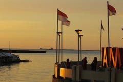 在Losari望加锡南苏拉威西岛印度尼西亚的日落 图库摄影