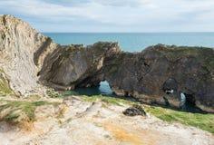 在Lulworth小海湾,英国的台阶孔 库存照片