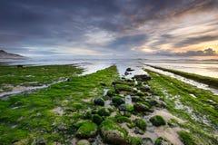 在Magoito海滩的美妙的日落  免版税库存照片