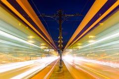 在Margeret桥梁的被弄脏的电车在晚上布达佩斯 免版税库存图片