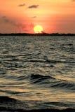 在Maron海滩,三宝垄,印度尼西亚的日落 免版税库存照片
