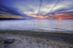 在Michigan湖的五颜六色的日落 库存照片