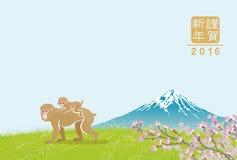 在mt的猴子家庭 富士-日本新年卡片 免版税图库摄影