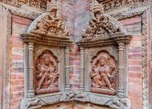 在Mul Chowk庭院墙壁, Hanuman Dhoka王宫, Patan Durbar广场, Lalitpur,尼泊尔上的被雕刻的雕象 免版税库存图片