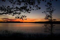在Necko湖的Colorfull日落 Masuria,波兰 免版税库存照片