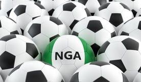 在Nigerias国民颜色的足球 免版税库存照片