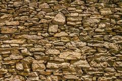 在Nonza附近的古老石墙在盖帽Corse在可西嘉岛 免版税库存照片