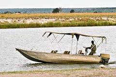 在Okavango Delta的小船 免版税库存图片