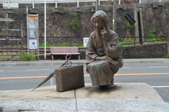 在Onomichi日本的林芙美子雕象 免版税库存照片