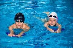 在poo的小孩游泳 免版税图库摄影