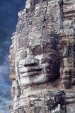 在Prasat Bayon寺庙,柬埔寨的巨型石面孔 免版税库存照片