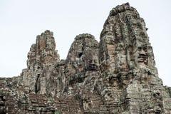 在Prasat Bayon,吴哥窟的巨型石面孔 免版税库存图片