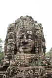 在Prasat Bayon,吴哥窟的巨型石面孔 库存图片