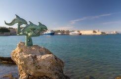 在Rhodos的四只海豚 免版税库存照片