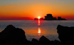 在Rovigliano岩石的日落 库存照片