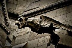 在Sacre Coeur大教堂的面貌古怪的人 库存照片