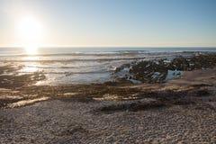 在Seapoint海滩的日落在开普敦 免版税库存照片