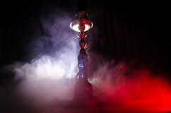 在shisha的水烟筒热的煤炭滚保龄球有黑背景 时髦的东方shisha 免版税库存图片
