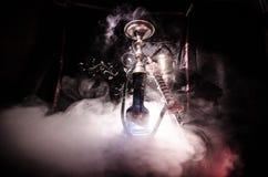 在shisha的水烟筒热的煤炭滚保龄球有黑背景 时髦的东方shisha 图库摄影