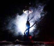在shisha的水烟筒热的煤炭滚保龄球有黑背景 时髦的东方shisha 库存照片
