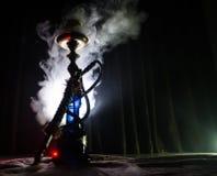 在shisha的水烟筒热的煤炭滚保龄球有黑背景 时髦的东方shisha 免版税图库摄影