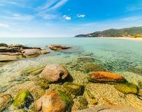 在Solanas海滩的岩石 库存图片