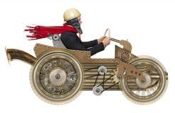 在steampunk汽车的商人 免版税库存照片