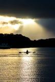 在Sunset湖的划艇 免版税库存照片