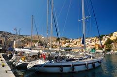 在Symi海岛停泊的小船  库存图片