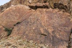 在Tamgaly Tas,哈萨克斯坦的刻在岩石上的文字菩萨 库存照片