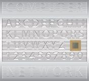 在Techno样式的字母表信函和编号 图库摄影