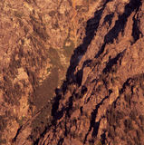 在Tetons的东部面孔的温暖的日出光,大蒂顿国家公园,怀俄明 免版税库存图片