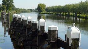 在Tolhuissluis附近的着陆阶段在Amstel-Drecht运河 库存照片
