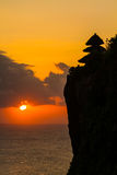 在Uluwatu巴厘岛印度尼西亚的日落 免版税库存照片