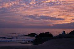 在Vagator海滩的日落 库存图片