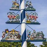 在Viktualienmarkt,慕尼黑,德国的巴法力亚五月柱 标志  库存照片