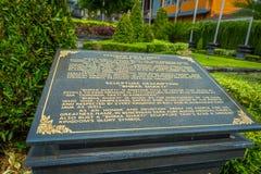 在Vishnu一个黑水泥石头雕象的情报标志在Gunung Kawi,巴厘岛,印度尼西亚 免版税图库摄影