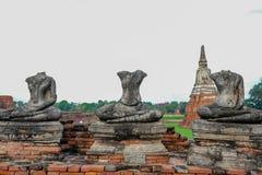 在Wat ChaiWatthanaram的3个没有头菩萨图象 库存照片