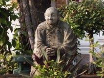 在Wat Pho寺庙地面的石雕象在曼谷,泰国 库存照片