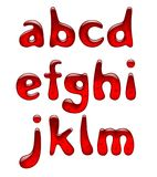 在wh隔绝的套红色胶凝体和焦糖字母表小字母 免版税图库摄影